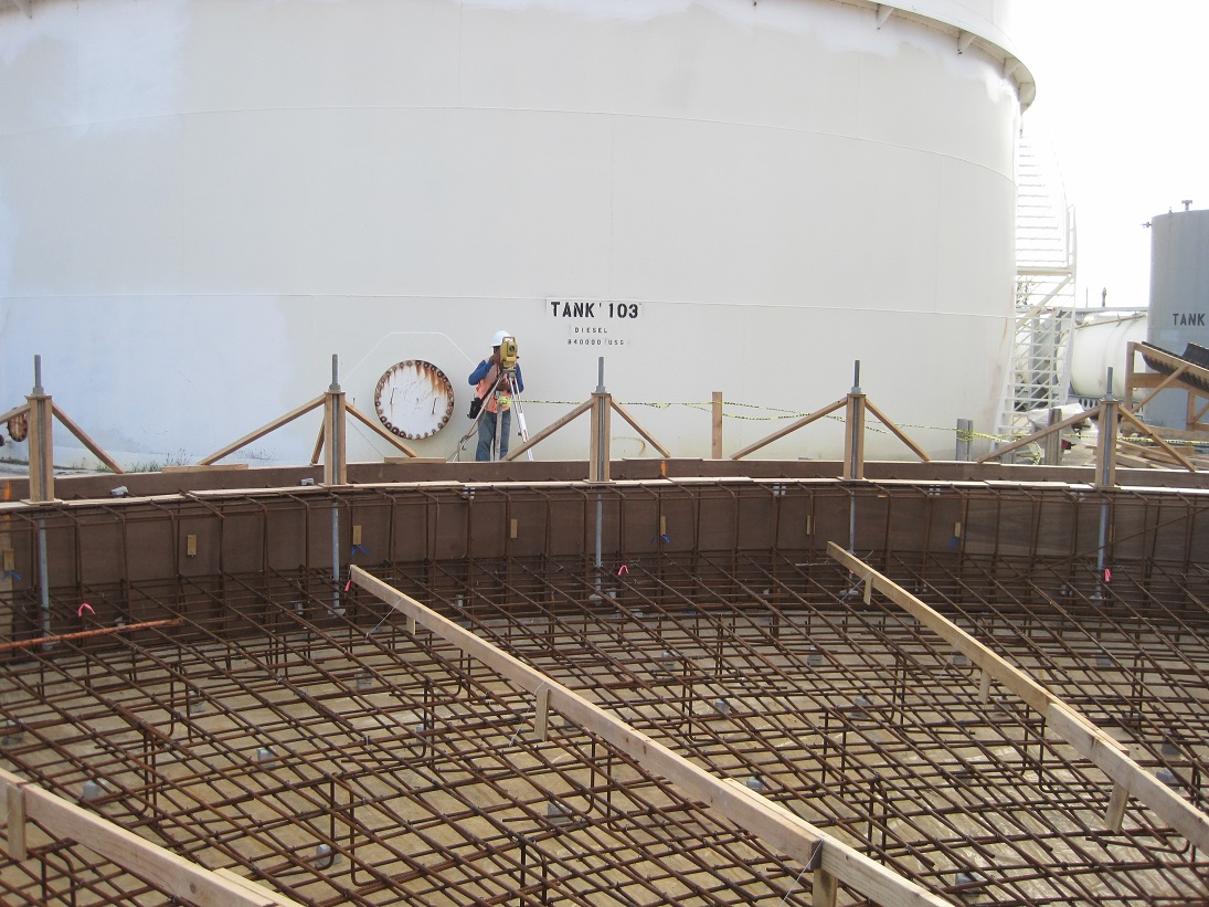 Rebar Foundation in front of white diesel fuel storage tank