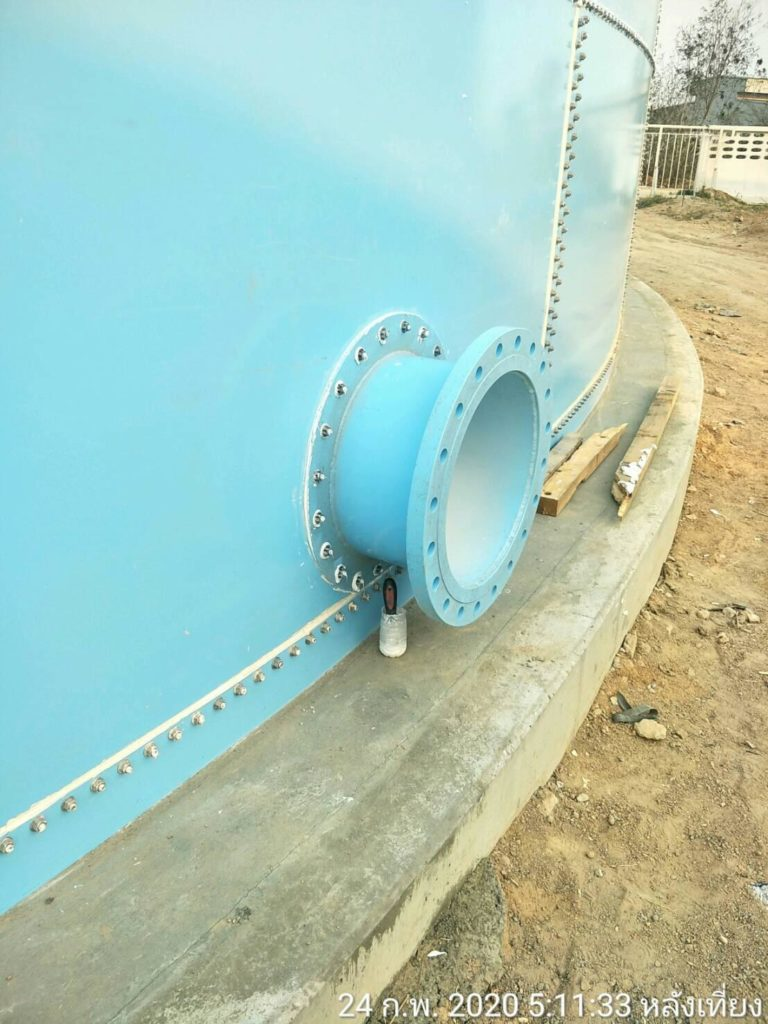 Circular blue nozzle attached to a bolted steel tank