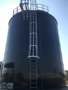 Dark blue bolted tank with safety ladder
