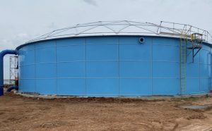 Bright blue bolted water tank with aluminum dome