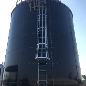 Large dark blue Bolted Steel Tank with ladder and cate