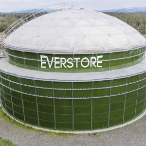 Closeup of a green bolted tank with an aluminum dome and an EVERSTORE logo