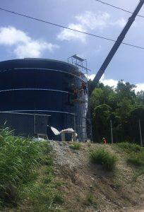 Blue Glass Fused to Steel Bolted Tank being installed on a hill