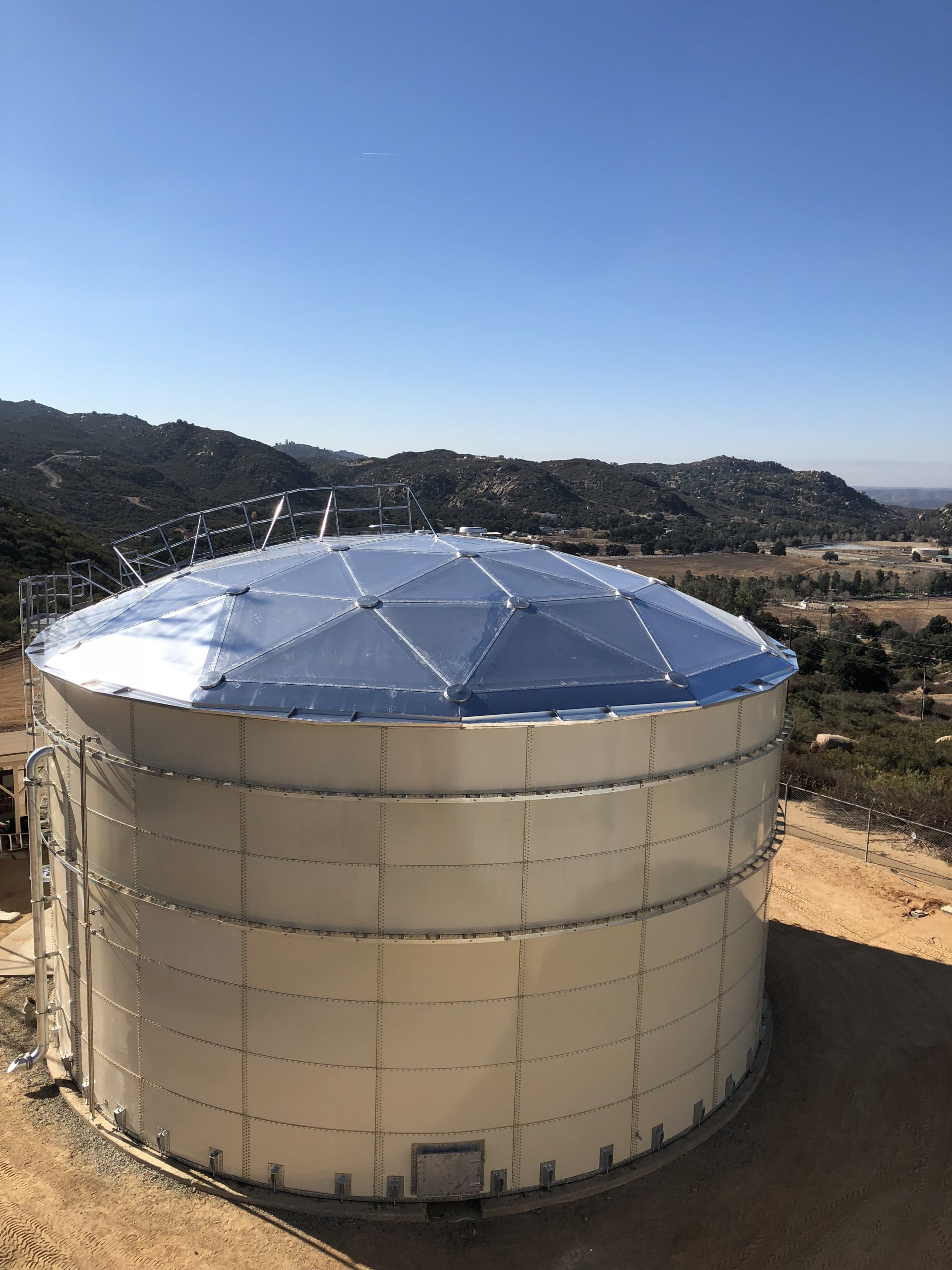 Epoxy Bolted Tank with Aluminum Dome Roof on a hillside