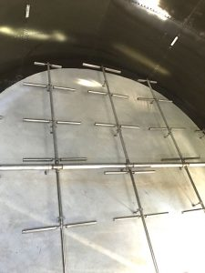 Surge tank floor in a bolted storage tank
