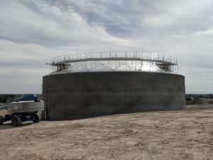 Concrete storage tank with aluminum geodesic dome