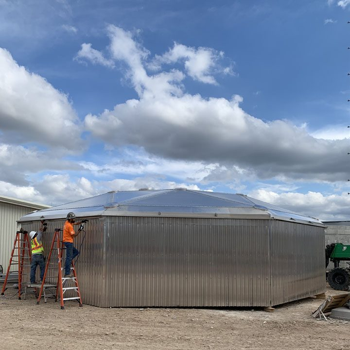 Installing the side panels on an aluminum geodesic dome