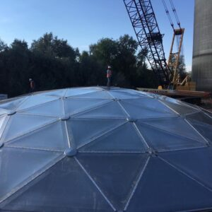 Installer on top of a geodesic dome in Texas