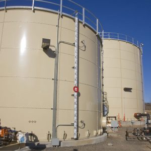 Two tan Epoxy Bolted Water Tanks with level indicator