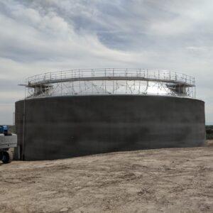 Concrete storage tank with aluminum geodesic dome