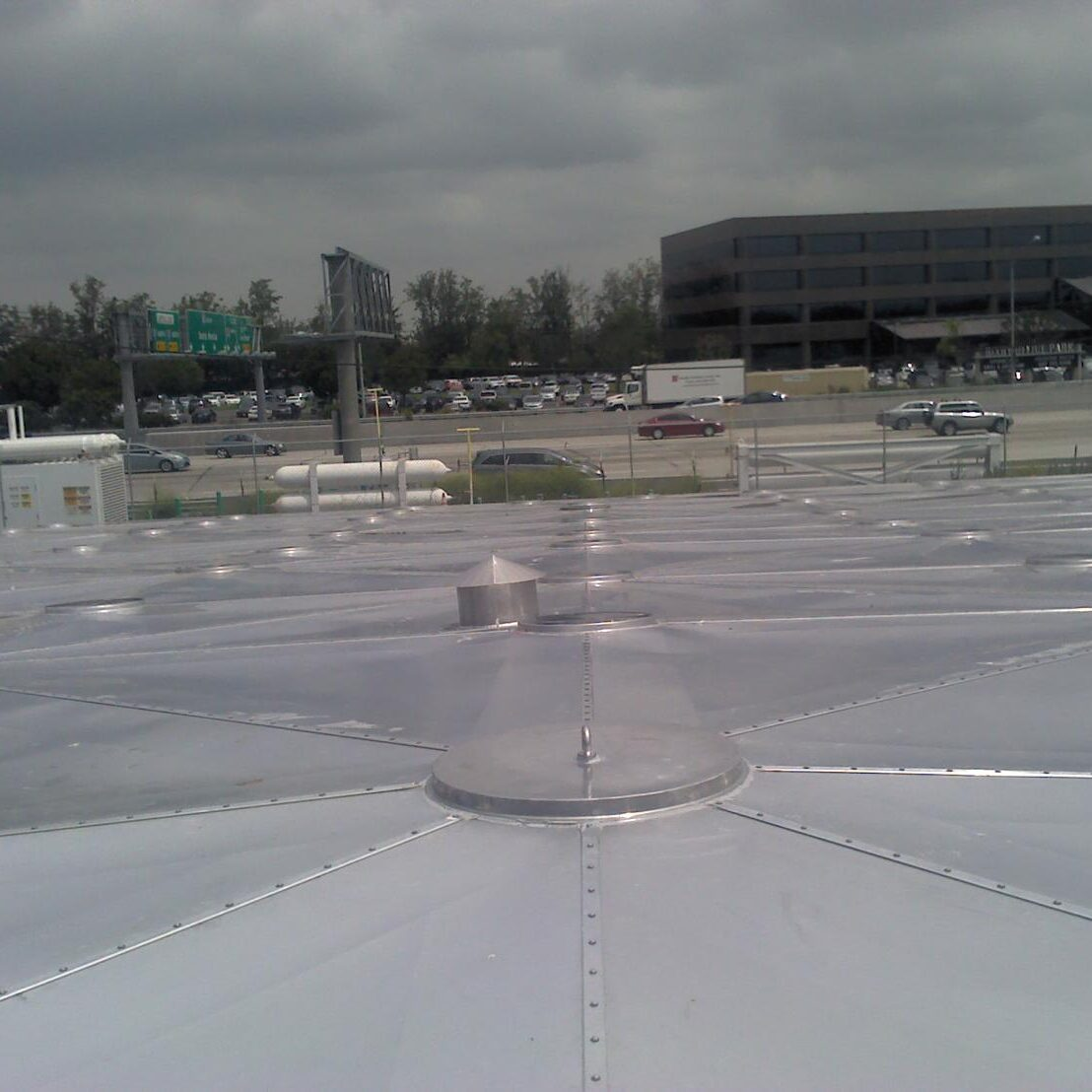 Aluminum Geotruss Reservoir Cover with freeway in background