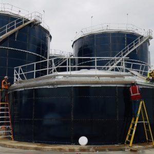 Three cobalt blue, glass lined storage tanks