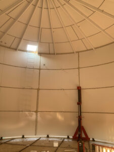 Inside view of a bolted water tank with jack