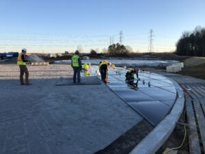 Men placing panels on a Glass Fused to Bolted Tank Steel Floor