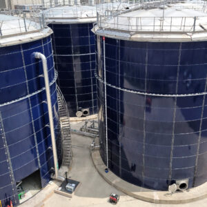 Six blue bolted steel water tanks